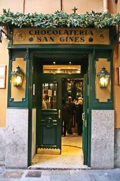 Travel Inspiration for Spain - Chocolatería San Ginés in Madrid, open since 1894. They serve the best churros in Madrid in this place! Super tasty.