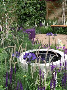 'Half hidden' in the Garden, is akin to the sexy woman, who partially reveals herself & is therefore far more alluring than the totally naked centrefold. Always, retain an air of mystery. Wellbeing of Women garden water feature