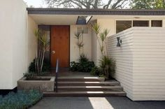 Midcentury modern house. I like how the design allows interior privacy on a busy residential street.