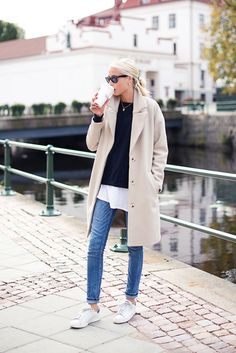 justthedesign: Ellen Claesson is wearing a coat, blue knit jumper from Filippa K, long white T-shirt from Acne, jeans from Zara and shoes from Adidas Stan Smiths