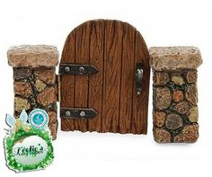 Fairy Garden Marshall Wooden Gate. www.teeliesfairygarden.com . . .  A perfect grandiose entrance for your fairy garden. Surely, the fairies and their friends would love to see what lies beyond this grandiose entrance. #fairygate