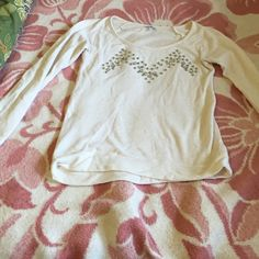 Express off white sweater Beautiful sweater. A couple of the big stones have fallen off but still in great condition. No tears. There's a tiny stein towards the bottom but isn't very noticeable. Express Sweaters
