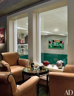 In New York Yankees pitcher C. C. Sabathia's New Jersey home, seating in the basement recreation room overlooks the indoor basketball court, which is complete with an electronic scoreboard.