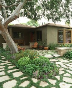 A Seat Wall And Broken Concrete Paving Extend The Patio Of This Modern  Craftsman Bungalow.