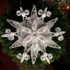 Quilled Snowflake with Microbeads by all things paper, via Flickr