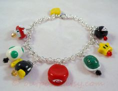 Mario Bros inspired charm bracelet Polymer clay Gamer by Outpost8, $30.00 Chain Chomp, Mario Hat, Crystal Beads, Crystals, Fimo Clay, Clay Charms, Mario Bros, Clay Creations, Beaded Bracelets