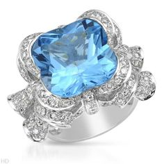Cocktail ring with diamonds and topaz.