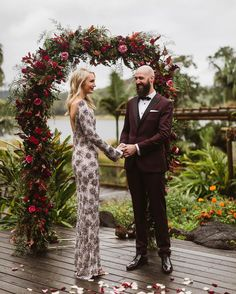 A heavenly embellished gown ✔ A groom in maroon ✔ And vows exchanged beneath a beautiful floral arch ✔ Just three (very good) reasons to adore this stunning pic from Boho Beach Wedding, Phuket Wedding, Elegant Wedding, Dream Wedding, Wedding Day, Wedding Colors, Wedding Styles, Boho Wedding Decorations, Burgundy Wedding