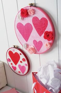 Use fabric in a variety of Valentine's Day colors to create pretty wall art - you just need Mod Podge and embroidery hoops!