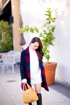 This Gap festive plaid car coat is the perfect layer for chilly days. Blogger Style by Alina layers it over a white turtleneck dress and tall boots. Shop Gap's car coat and other festive outerwear!