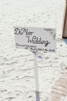 cute sign for beach wedding ceremony / Koru Wedding Style: {Pink & White Florida Beach Wedding} Laura & Stephen