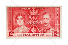 close-up shot of pink postage stamp. - Detailed shot of pink Mauritius postal stamp on white background.