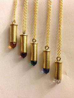 22 Caliber bullet necklace, i love the red one! I love to go to shooting ranges!