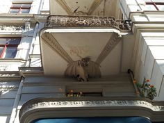 Dragons holding up balconies on Elizabetes Street in Riga.