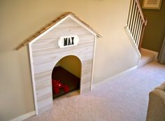 _DoggyDoor - a dog house and bed built into an unused space under a stairway