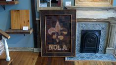'Floor de Lis' -  Built out of scrap pieces of 100+ yr old, reclaimed heart-pine flooring.  Routed a Fleur de Lis into the flooring after it was patched together.