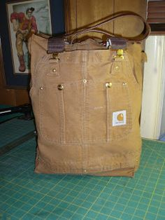 A tote bag made from the top of old bib overalls.