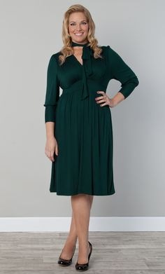 "Real Curve Cutie Jacquie is looking elegant and classy in the Plus Size Duchess Day Dress in Green with Envy.  She's statuesque at 5'11"" and a size 0x.  #KiyonnaPlusYou #PlusSize #Kiyonna"
