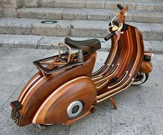 Custom Wood Vespa. A few years ago, Portuguese carpenter Carlos Alberto became the Best Dad in the World when he carved his daughter Daniela a Vespa-styled scooter almost entirely out of wood. A 50cc motor and a pair of roulette-rimmed wheels make the Vespa go.