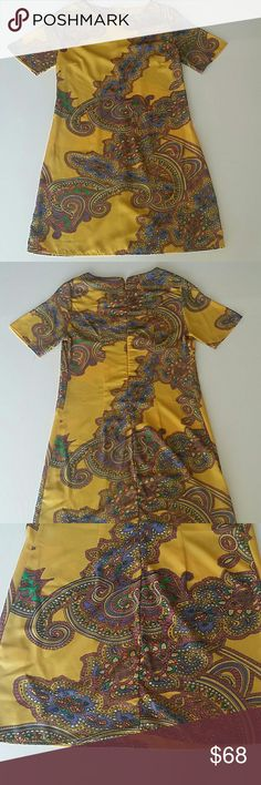 Beautiful, vibrant, fun gold patterned dress Small size (S), length: 31 in., waist: 17 in., sleeve: 8.5 in.  Back zipper. 100% polyester. Dresses
