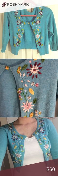 Short summer flower sweater Perfect as a summer time light sweater! This sweater is hand embroidered with flowers, sequins, and beads. Bought at a boutique in Napa CA in a beautiful light blue color with a small little ball as a button. There is slight discoloration under the arm, last pic. Perfect over a summer dress! Size small but is very stretchy and fits me just fine, I'm usually a M or L. Sweaters Cardigans
