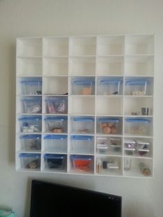 Cubby storage I built to get stuff off of work table. Made with Foam board and dollar store containers...