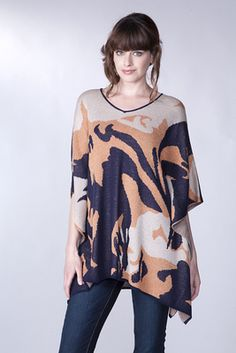 This fun and funky navy and orange combination is a v-neck poncho style sweater. Very roomy and comfortable. Shop Lillians of St. Charles, MO.. NOW!