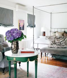 Fashionable French apartment. like the pop of green against the grey