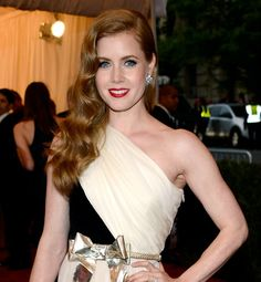 """""""Since red is an intense color, romantic waves or curls will soften the overall look,"""" says Colette Hagiwara, color director of Yoshi Hair Studio in Beverly Hills. Here, Amy Adams' chestnut locks look downright ethereal."""