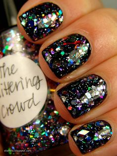 Black nails with multicoloured glitter. Nails. Nail art. Beauty. Nail polish.