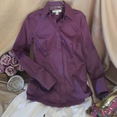 Banana Republic non iron fitted shirt Beautiful button down shirt with long, cuffs in a non-iron fabric that feels silky smooth to the touch. Gorgeous, rich purple solid fabric. Never worn. Excellent condition. Pet/smoke free home. Banana Republic Tops Button Down Shirts