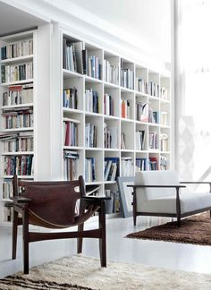 My dream living room, or library...  --- I like that the shelves curve around the corner.