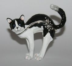 Black & White CAT Stretching. Supplied in Black Gift Box. TRINKET BOX. Heavy Metal Trinket Box with Enamelled Finish. Pull Back Cat's Head to Open Trinket along Central Seam.
