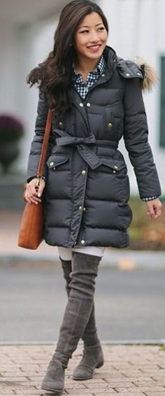 Cognac shoulderbag against charcoal quilted overcoat, gingham top, smile, chestlength dark hair, grey stretch-suede boots