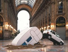 'white car and trailer' by michael elmgreen & ingar dragset installation at galleria vittorio emanuele, milan image courtesy fondazione nico...