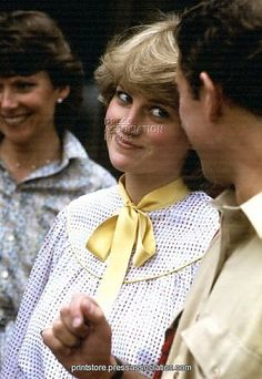 Love the playful look! Lady Diana Spencer looking at her future husband Prince Charles...