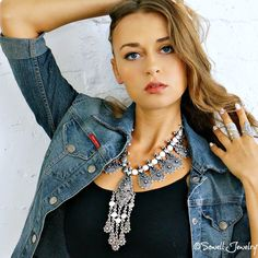 Exotic tribal collar featuring statement fringe pendant. Toggleclosure.  Length: 27-29 inches Material: Silver plated metal Item#: NE1701