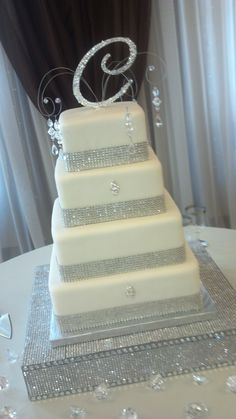 Would make a great milestone birthday or wedding/anniversary cake! Totally awesome add some purple bling to that and it would be an awesome cake, minus the c of course! But add whatever initial on top that The Lord blesses you with! Bling Wedding Cakes, Bling Cakes, Square Wedding Cakes, Wedding Cake Designs, Fancy Cakes, Wedding Cake Toppers, Sparkle Wedding, Beautiful Wedding Cakes, Gorgeous Cakes
