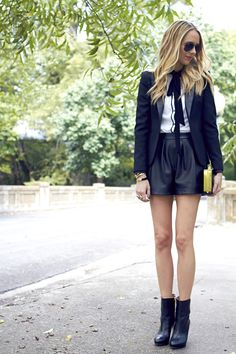 black blazer, black leather shorts, white button-up bow blouse, black booties