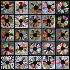 25 Dresden plate blocks by Upstate Lisa; I like the black and gray background fabrcs and black centers on this quilt