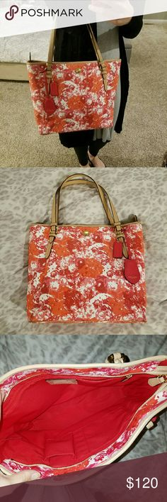 """COACH Red Print Leather Handbag Coach red print leather handbag in excellent shape. Only worn a handful of times. Has a tiny little mark above the strap, but never noticed it until looking it over to sell. Measurement is width: 15.5"""" and height: 19"""" from top of strap to bottom of handbag. Interior is spotless. Only selling because I don't use it much. Coach Bags"""