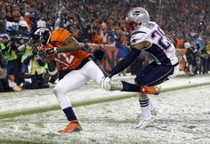 Denver Broncos wide receiver Andre Caldwell (12) pulls in a touchdown catch as New England Patriots cornerback Logan Ryan (26) defends during the second half of an NFL football game, Sunday, Nov. 29, 2015, in Denver. (AP Photo/Jack Dempsey)