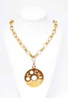 7b6b5d6133b9c Stand out with this huge vintage Chanel logo necklace.