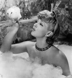 Lana Turner blowing Bubbles