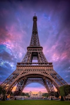 Paris, France with a colorful sky as the backdrop to the Eiffel Tower.