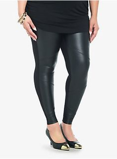 Faux leather panels with seam detailing add some serious edge to this black pair of leggings.