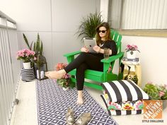 Create a seating space in either a small patio or balcony with a brightly colored Adirondack Chair and bold accessories!   From Mandy of Fabric Paper Glue and The Home Depot Patio Style Challenge