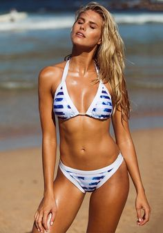 Swimwear // Bring out all the glory of summer in this inked blue striped halter bikini set.