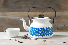 "A very rare small mid century modern Scandinavian teapot by Esteri Tomula, who took a very keen interest on flowers. This design is called ""Hepatica"" circa Marked on the bottom ""FINEL Made in Finland"". Enamel Teapot, Cheese Dome, Kitchenware, Tableware, Vintage Tea, High Tea, Vintage Prints, Tea Set, Tea Sets"