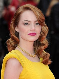 Emma Stone The Amazing Spider-Man 2 red carpet beauty look: bold fuchsia pink lipstick with Veronica Lake vintage waves | allure.com